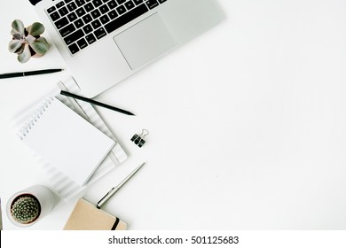 Stylish office table desk. Workspace with laptop, diary, succulent on white background. Flat lay, top view