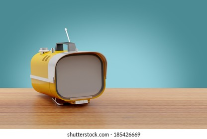 Stylish orange retro TV mobile sixties, on a table