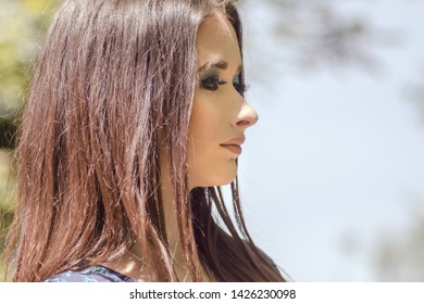 Stylish outdoor portrait of young beautiful fashionable woman with long hair posing. Female fashion, beauty concept