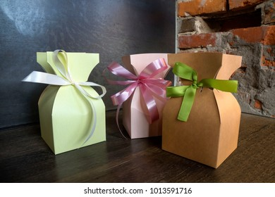 Stylish paper box, tied a satin ribbon closeup.