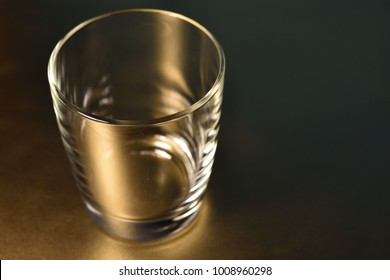 Stylish photo of empty glass in warm lights