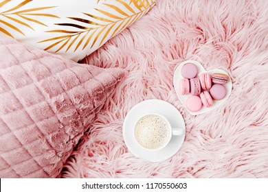 Stylish pink pillows and cup of coffee. Copy space. Flat lay, top view