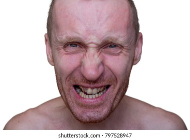 Stylish portrait of adult caucasian man with angry face and who seems like maniac. His face is twisted with anger. Man's teeth in bad condition. Isolated on white.