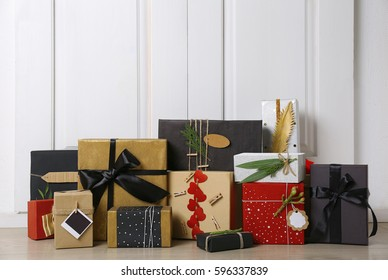 Stylish present boxes on white wooden board background