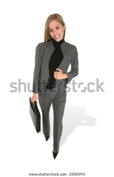 A stylish, pretty business woman walking with briefcase