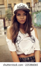 Stylish pretty hipster swagger girl portrat. Outdoor fashion style portrait of young beautiful woman
