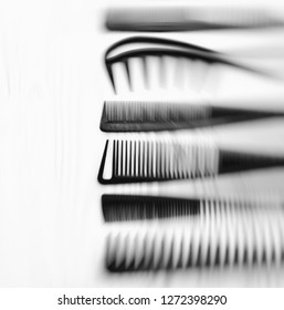 Stylish professional barber comb set, hairdresser salon concept, Hairdressing tool set. Haircut accessories. Abstract bacground