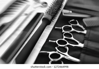 Stylish professional barber scissors and combs, hairdresser salon concept, hairdressing tool set. Haircut accessories