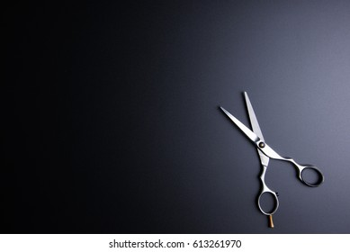 Stylish Professional Barber Scissors, Hair Cutting on black background. Hairdresser salon concept, Hairdressing Set. Haircut accessories. Copy space image, flat lay