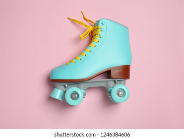 Stylish quad roller skate on color background, top view