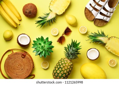 Stylish rattan bag, coconut, birkenstocks, succulent, sunglasses and yellow fruits on sunny background. Banner. Top view with copy space. Trendy bamboo bag and white shoes. Summer fashion flat lay.