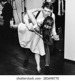 stylish retro bride and groom dancing first wedding dance swing