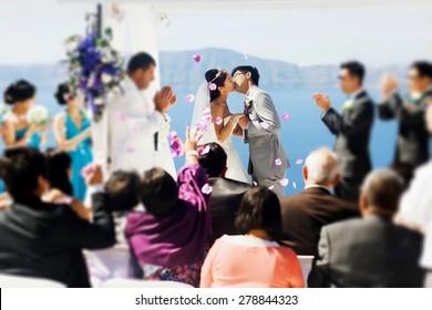 stylish rich smiling asian bride and groom  weddingr in island Santorini greece sunshine