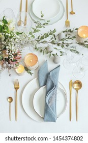 Stylish and romantic dinning table decor with candles. All natural woodland theme.