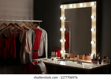 Stylish room with dressing table, mirror and wardrobe rack