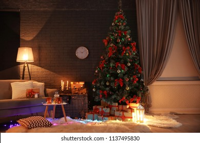 Stylish room interior with decorated Christmas tree