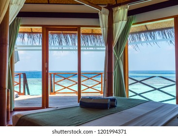 Stylish room with an ocean view, tranquil turquoise Water.  Maldives. With selective focus
