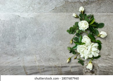 Stylish roses flat lay. White roses border on pastel grey background with space for text. Happy mothers day, floral greeting card mockup. International Womens Day. Valentines day