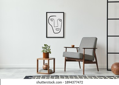 Stylish scandinavian composition of living room with design armchair, black mock up poster frame, plant, wooden stool, book, decoration, loft wall and personal accessories in modern home decor.