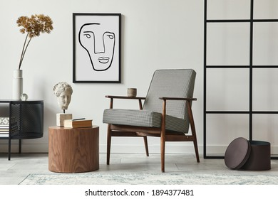 Stylish scandinavian composition of living room with design armchair, black mock up poster frame, commode, wooden stool, book, decoration, loft wall and personal accessories in modern home decor. - Shutterstock ID 1894377481
