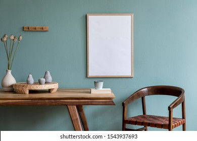 Stylish scandinavian dining room interior with mock up poster frame, wooden table, furniture, cupof coffee, flowers , cement fruits and elegant accessories. Ready to use. Template. Modern home decor. - Shutterstock ID 1543937693