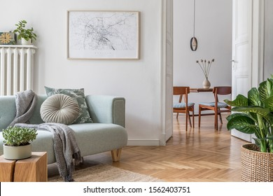 Stylish scandinavian living room with design mint sofa, furnitures, mock up poster map, plants and elegant personal accessories. Modern home decor. Open space with dining room. Template Ready to use.  - Shutterstock ID 1562403751