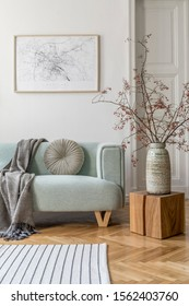 Stylish scandinavian living room interior with design mint sofa, furnitures, mock up poster map, plants, and elegant personal accessories. Home decor. Interior design. Template. Ready to use.