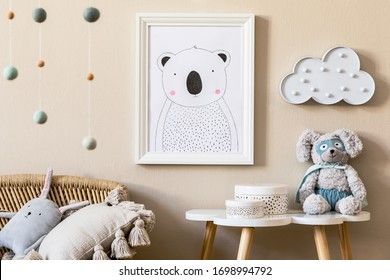 Stylish scandinavian nursery interior with mock up photo frame, plush dino, design furniture, beautiful decoration, toys and accessories in modern home decor.