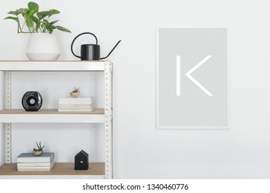 Stylish scandinavian open space interior with white bookstand, plant ,accessorries and mock up poster frame. Concept of mockup poster with white stand. White baclgrounds wall.