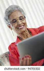 Stylish senior Black woman using a digital tablet