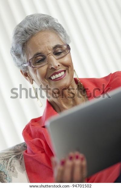 Stylish senior Black woman using a digital tablet