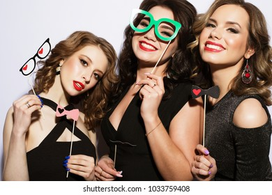 Stylish sexy girls best friends ready for party. Black dress and bright make up.