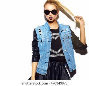 Stylish sexy smiling beautiful young blond woman model in summer bright jeans hipster clothes  in sunglasses