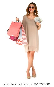 Stylish shopper woman with multicolored packages and money dollars in hand standing on a white isolated background. Shopping concept