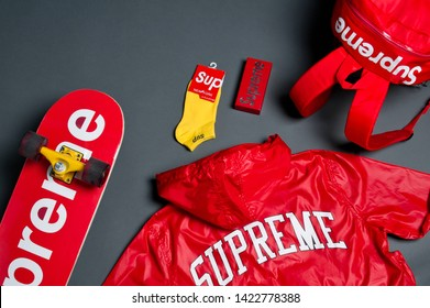 Stylish skateboarding outfit and accessories with longboard/skateboard, backpack and jacket from famous brand Supreme. Urban, subculture, skateboarding concept. Krasnoyarsk, Russia - August 15, 2017