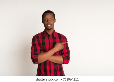 Stylish smiling black man in casual standing with cross arms portrait. White background in studio
