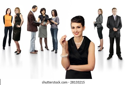 Stylish smiling business lady in front of team of business people isolated on white background