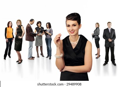 Stylish smiling business lady in front of team of business people all in focus at stuff meeting with client isolated on white background