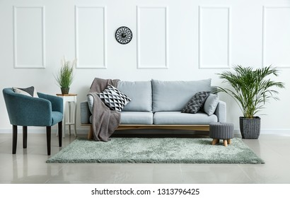Stylish soft furniture in interior of living room