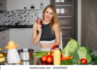 Stylish sports girl. Woman with vegetables. Lady in a sport clothes