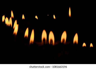 Stylish stack of candlelights with dark background isolated unique stock photo