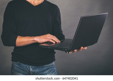 Stylish, successful business man with a laptop