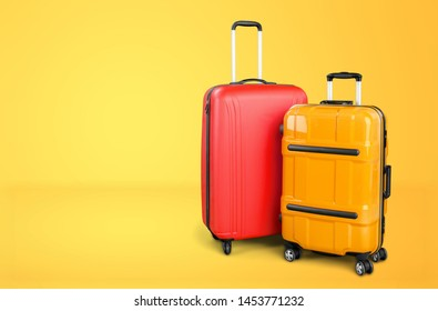 Stylish suitcases on color background. Space for text          - Image