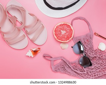 Stylish summer accessories, creative flat lay composition with pink sandals, sunglasses ans other.
