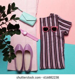 Stylish summer women's clothing and accessories. Trend Strip print. Top view.