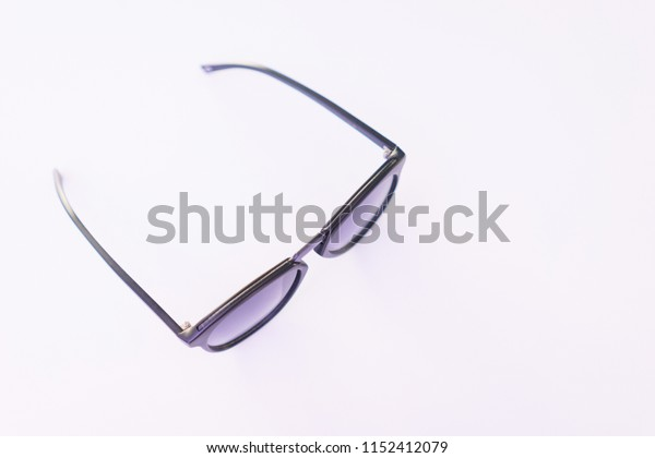 Stylish sunglasses on a white background. Modern fashion and eye protection from the bright sun. Soft focus and beautiful bokeh.