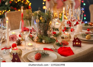 Stylish table setting with burning candles and Christmas decorations