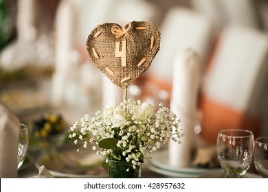stylish tastefully decorated with flowers and accessories hall of the restaurant to celebrate wedding