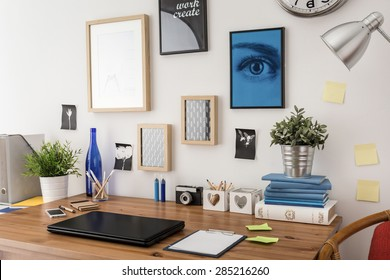 Stylish tidy wooden desk with data in office
