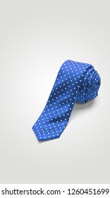 stylish tied blue tie isolated on white Gray studio shot of expensive modern silk tie